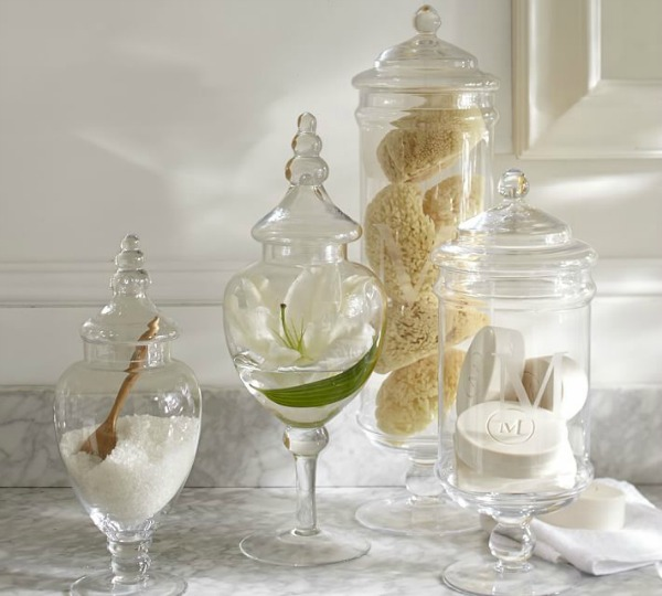 Use apothecary jars in your bathroom to hold soap, sponges, and bath salts. Lots more ideas for decorating with apothecary jars in this post!