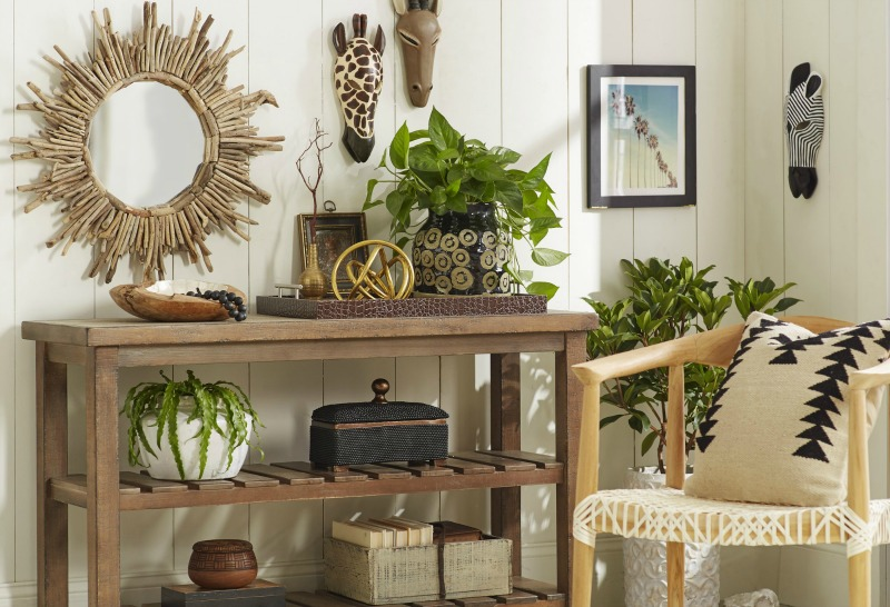 Love this driftwood sunburst mirror and how they arranged it with other accessories over a console!