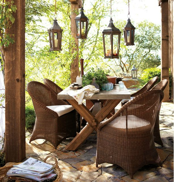 A group of lanterns hanging over an outdoor dining area - beautiful!