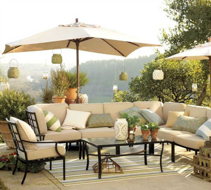 Lanterns hanging from outdoor umbrellas - perfect for entertaining!