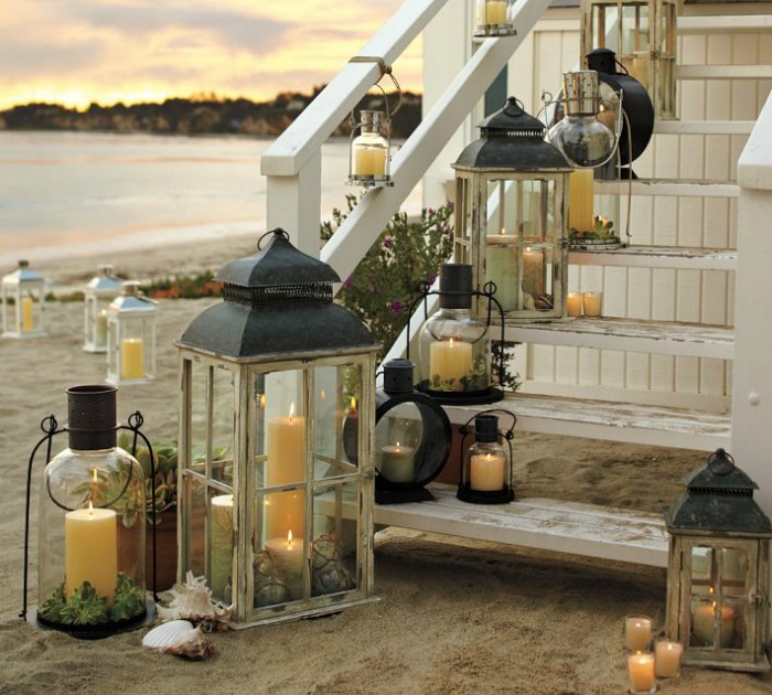 Different sized lanterns lined up along an exterior staircase - gorgeous