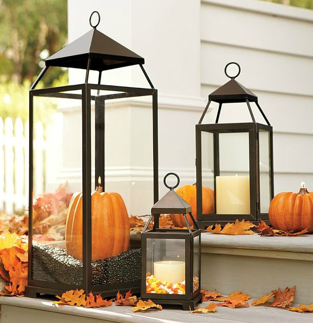 Such a clever way to use lanterns on your front porch in the fall!