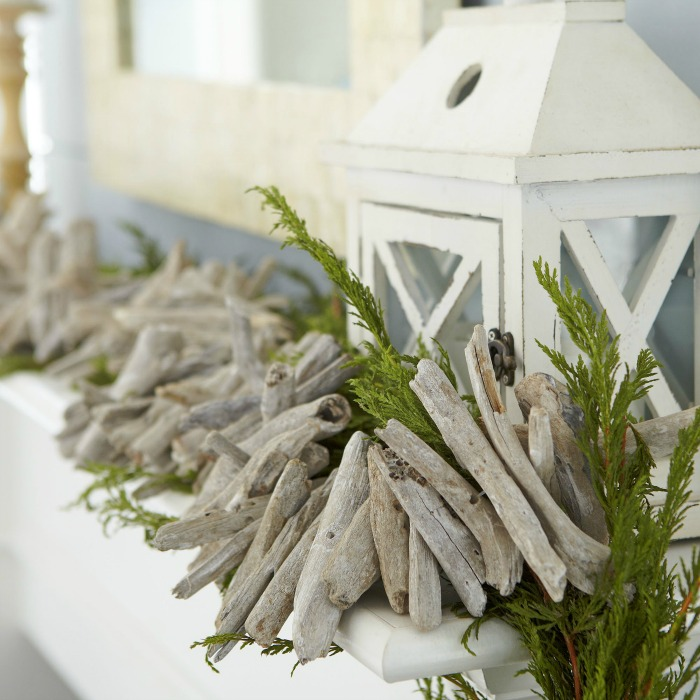 This whitewashed driftwood garland is PERFECT for decorating a fireplace mantel with a coastal flair!