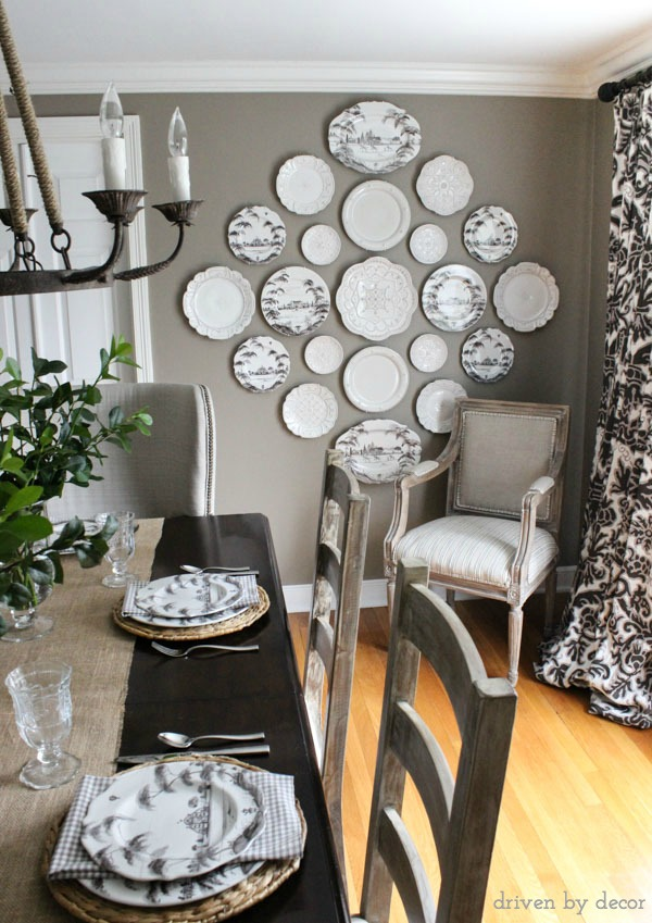 Dining room decorated in neutrals with stunning plate wall - love!