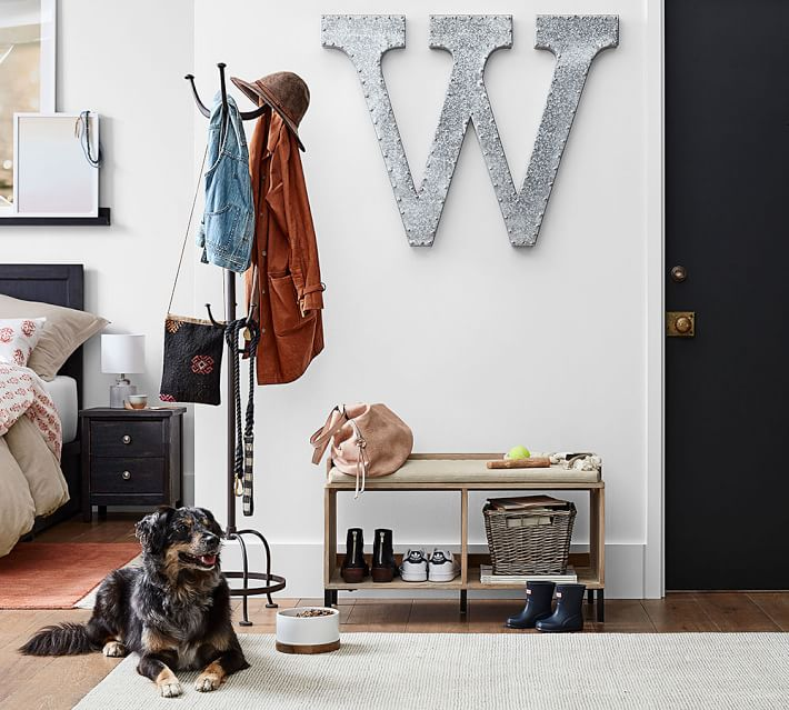 Love the look of a single oversized decorative letter as wall art!