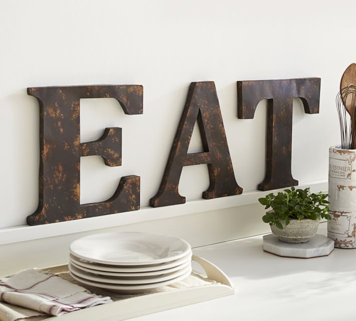 "Love these large decorative letters spelling ""EAT"" in the kitchen!"
