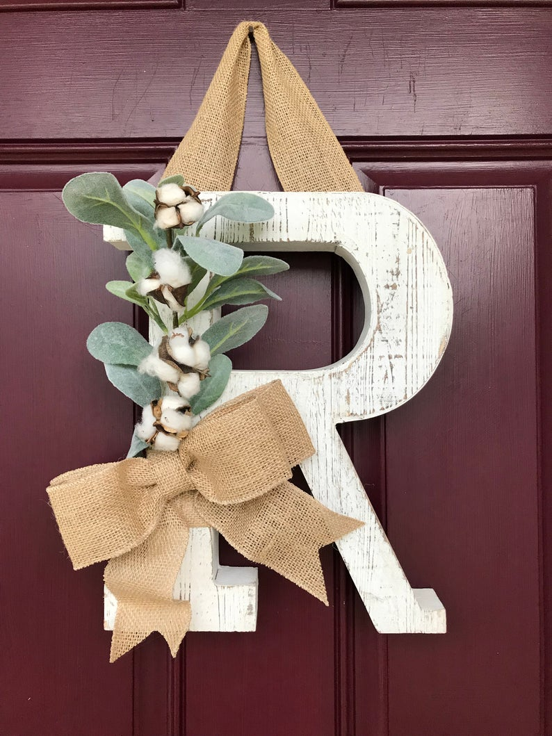 Love this whitewashed wood letter used as a front door decoration!
