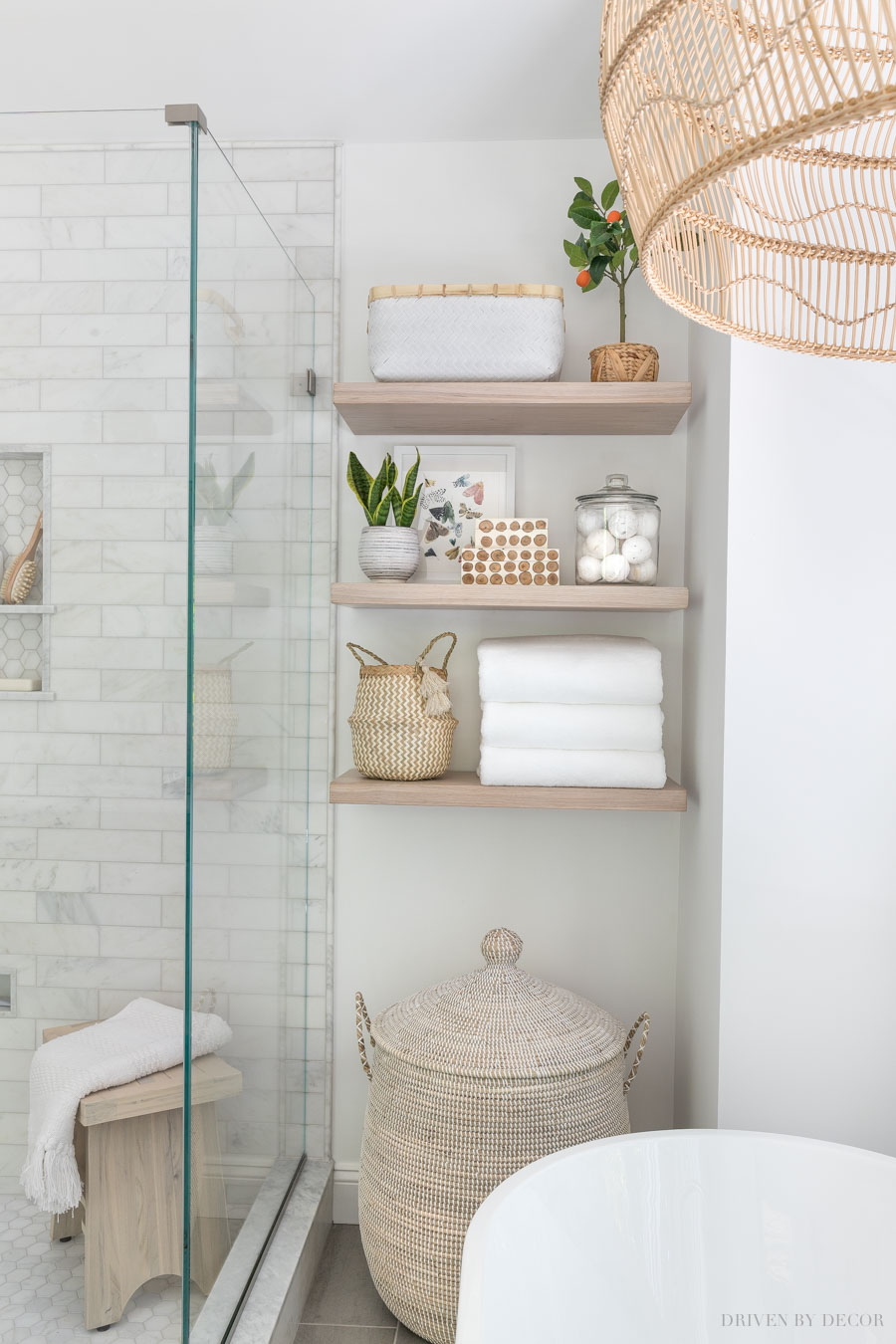 Love this large lidded basket she uses as a hamper in her master bathroom!