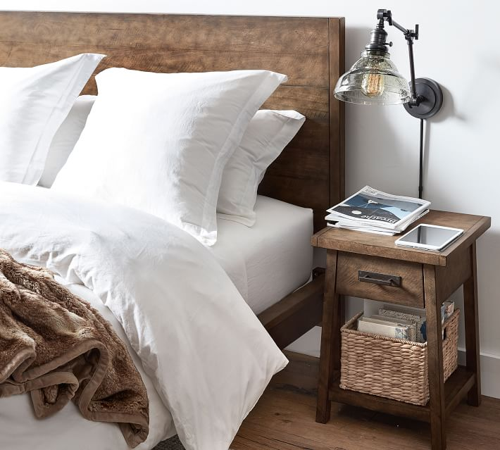 A seagrass basket on the bottom shelf on a nightstand is perfect for corralling clutter!