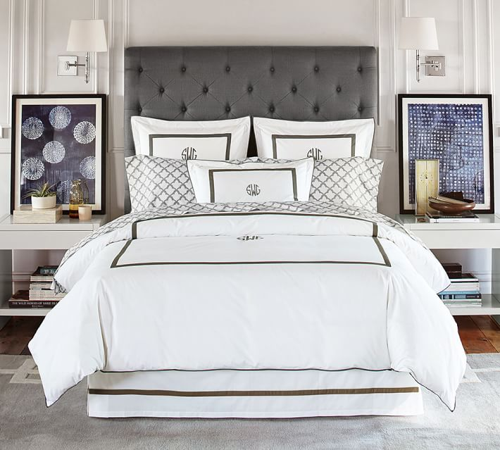 Indigo art adds the perfect pop of color to this gray and white decorated bedroom!
