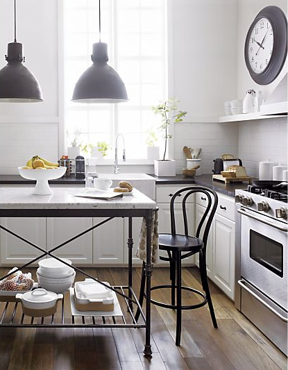 Beautiful kitchen with twin pendants over marble island