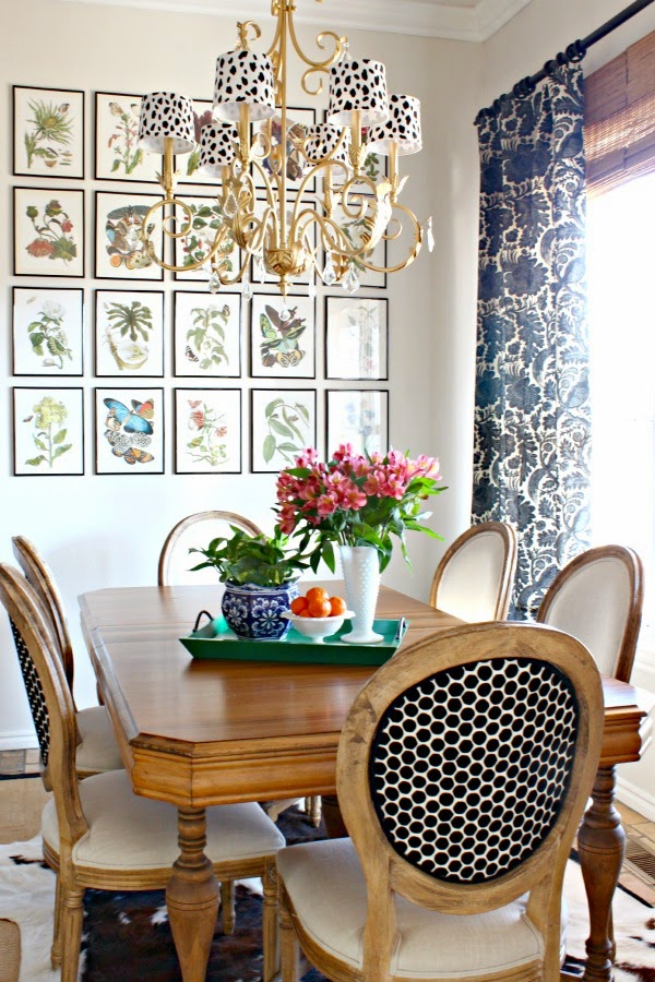 Breakfast nook by Dimples & Tangles with inexpensive art (pages from a book!) framed in grid pattern
