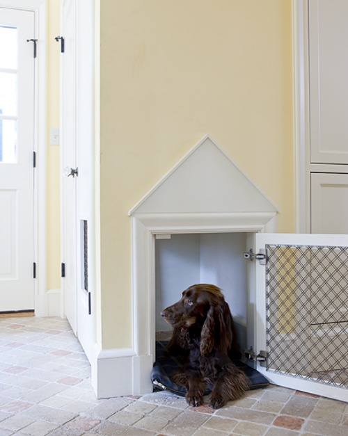 Dog kennel built into wall