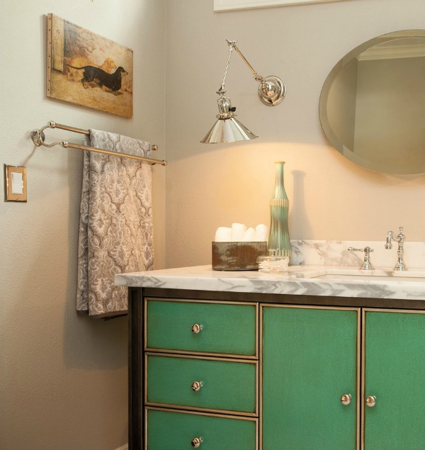 Swing arm sconce used in a bathroom