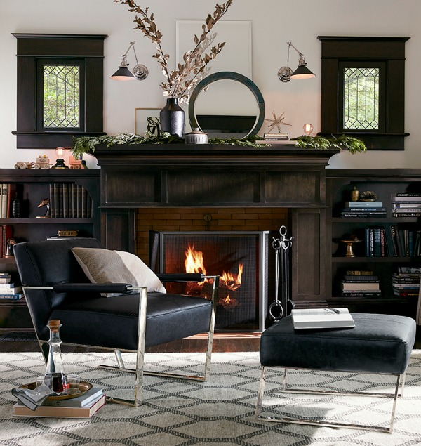 Swing arm sconces over a fireplace - such a cool look!