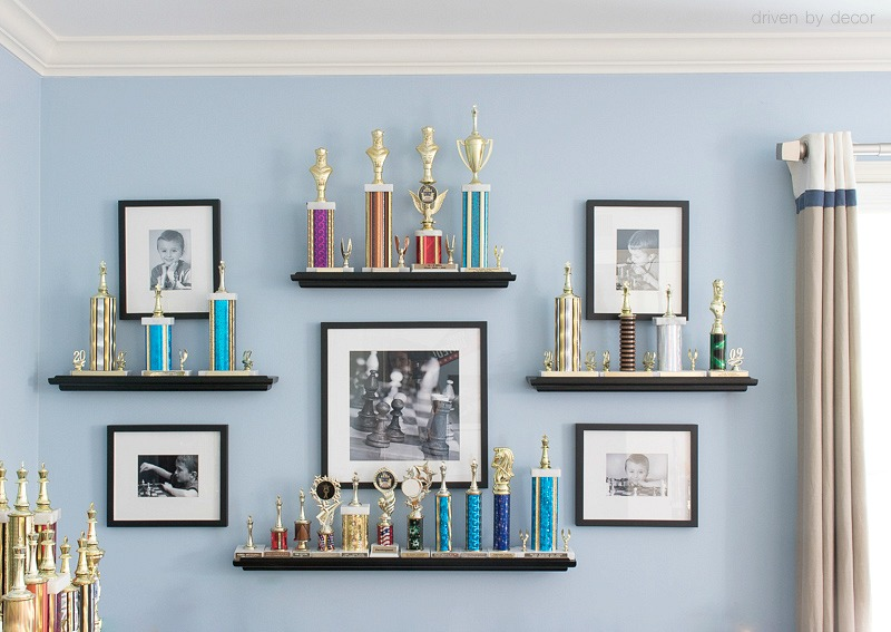 Such a great way to display kids trophies along with photos of your kids doing their favorite sport!