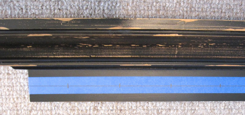 Use painters tape to mark off spacing for screwing knobs onto ledge shelf