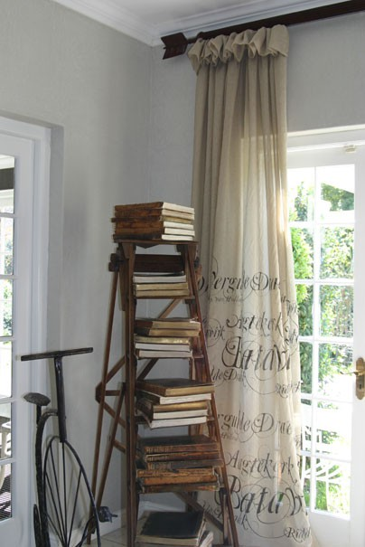 African Sketchbook ladder with books