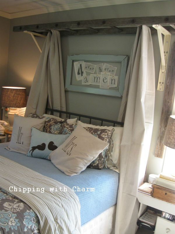 Vintage ladder used as charming canopy over bed