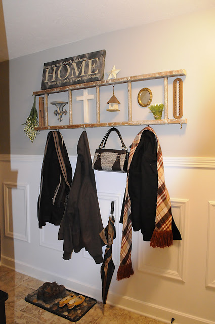 Vintage ladder used as coat rack