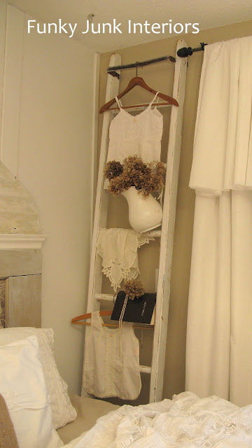 Vintage ladder used for hanging clothes