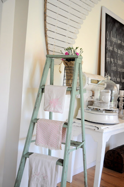 Vintage ladder used in kitchen for hanging towels