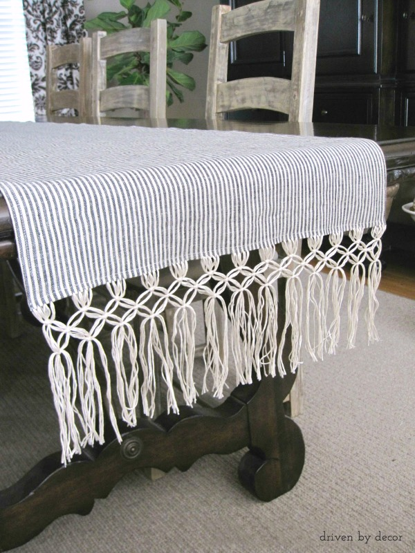 Make your own macrame fringe table runner by following this easier-than-you'd-think DIY tutorial!