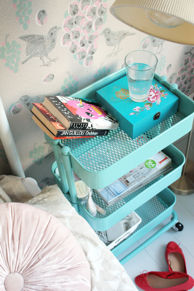 This rolling cart makes a unique small space nightstand