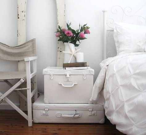 Paint a pair of old suitcases and stack them to create a unique nightstand!