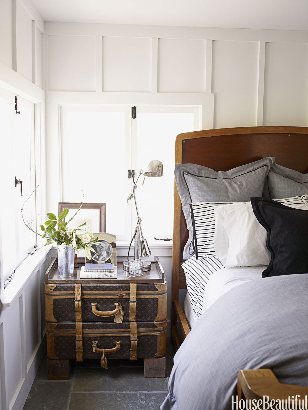 Stacked vintage Louis Vitton suitcases create a gorgeously unique nightstand!