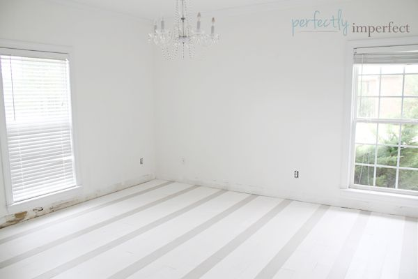 She used chalk paint to create these gorgeous subtle stripe floors!