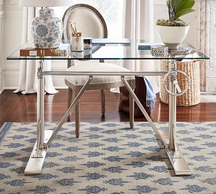 A glass top desk with a built in crank so you can use it sitting down or standing!