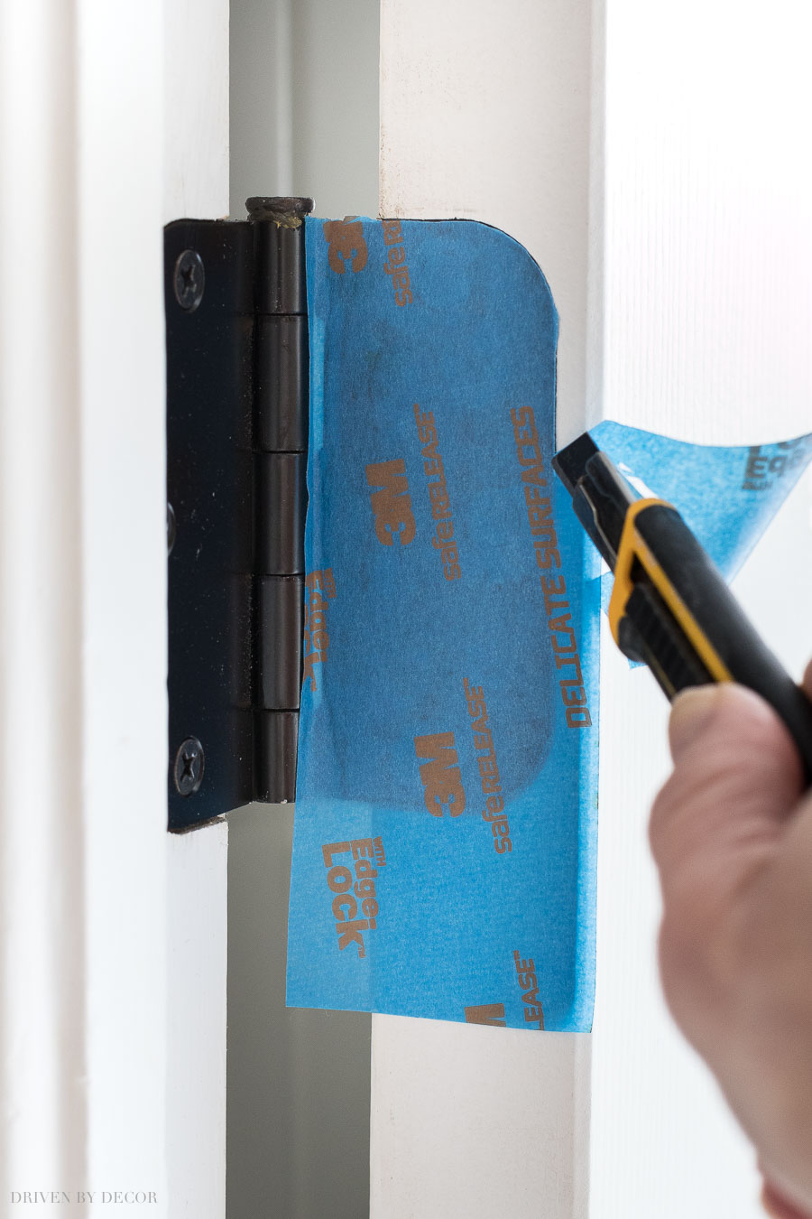 To prep your door for painting, cover hinges with painter's tape and use a razor cut away extra tape by tracing around them!