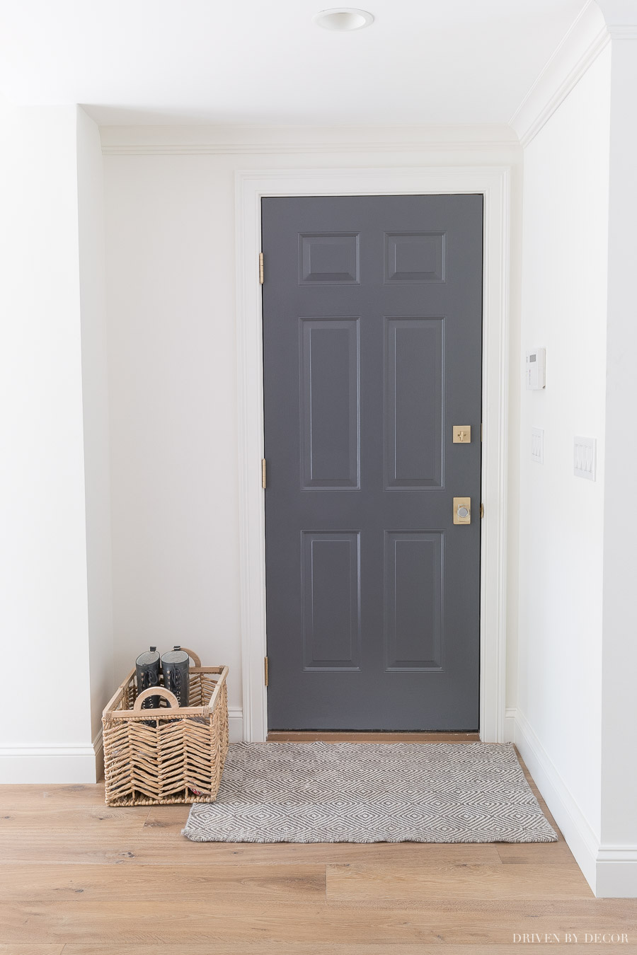 Tips for painting interior doors including choosing a paint color. Love this dark gray!