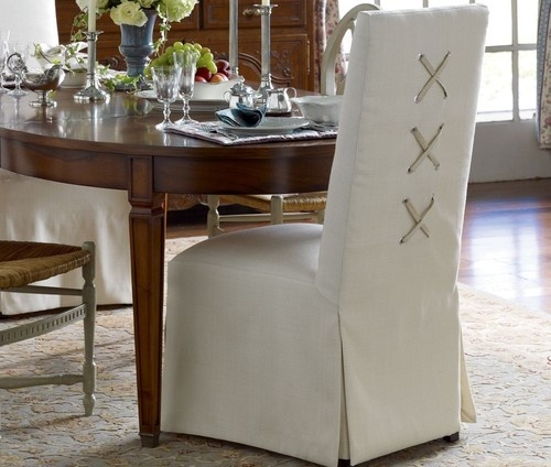 Slipcovered chairs with laced X back design