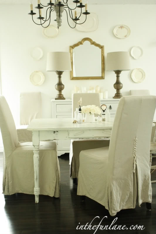 Slipcovered dining room chairs with unique corseted backs