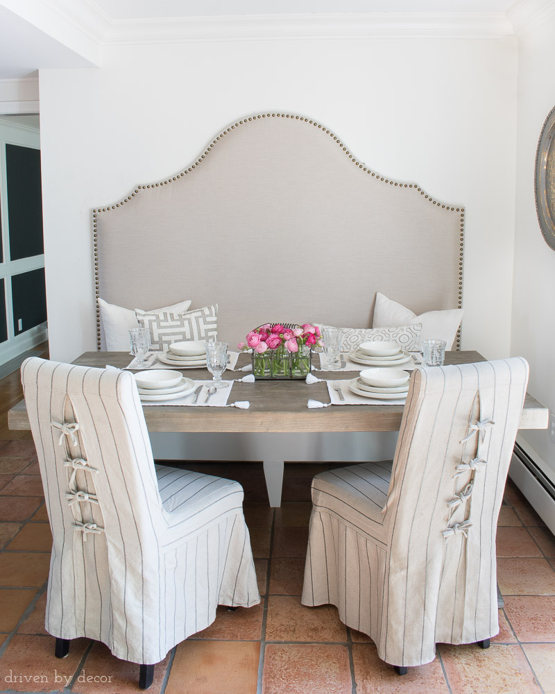 Our breakfast nook with a high backed banquette and slipcovered chairs with ties in the back!