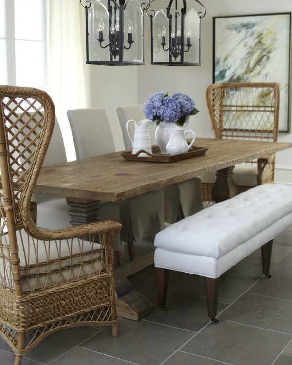 Superb Tall rattan end chairs paired with upholstered side chairs and a bench