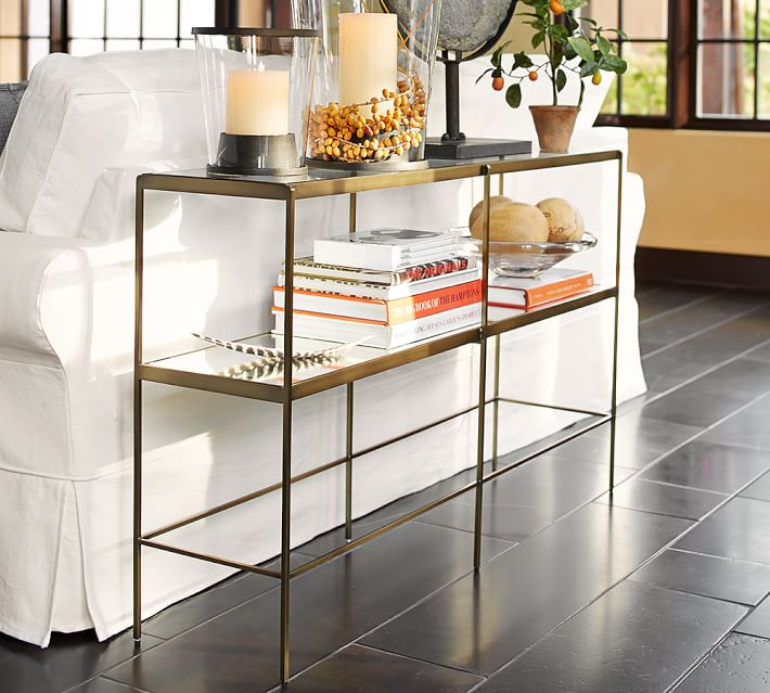 Love this brass and glass console table that's the perfect size for behind a sofa!