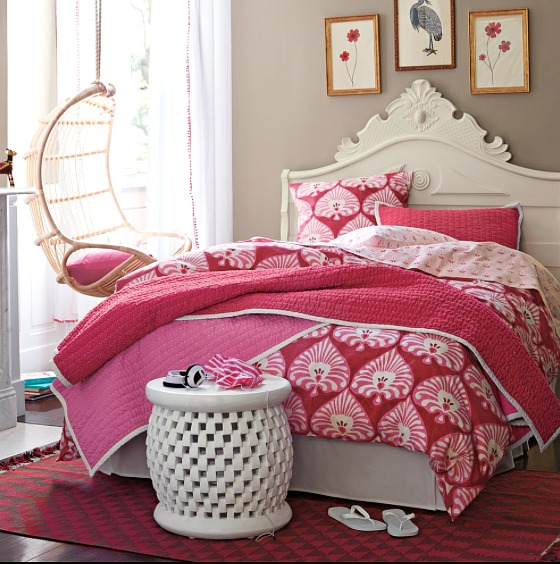A hanging rattan chair in a girl's bedroom - so cute and fun!