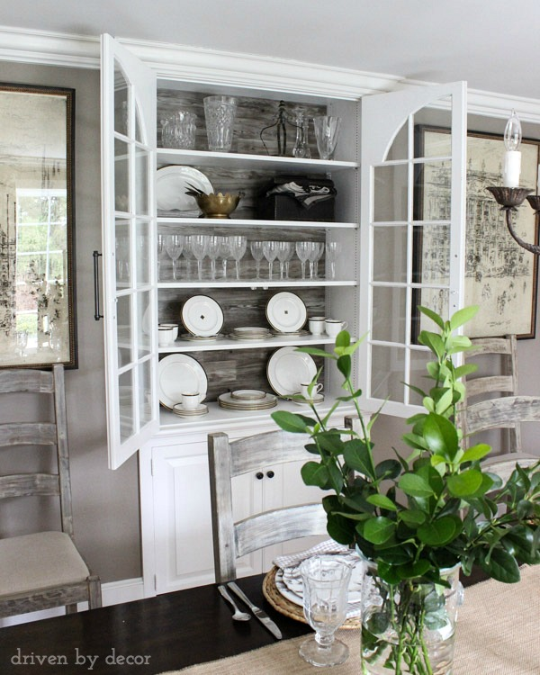 Built-in dining room china cabinet with wood backdrop and large pulls
