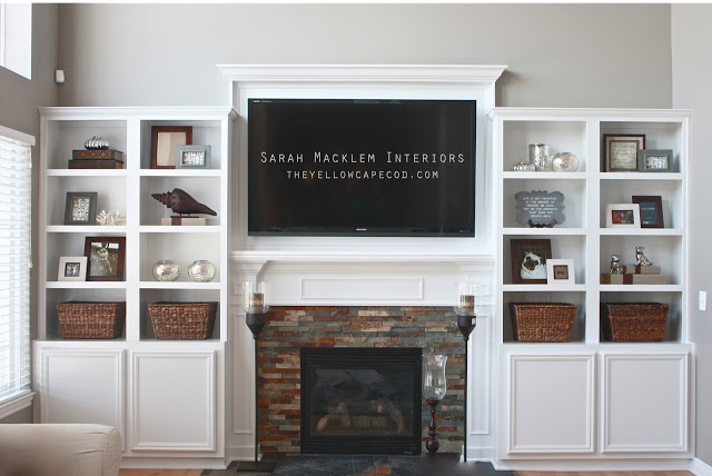 Loving the design of the TV mounted above the fireplace and bookcases on both sides!