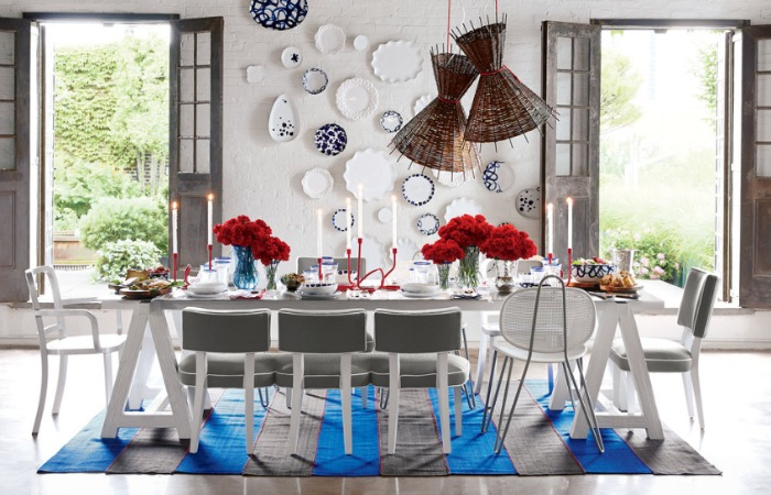 Gorgeous mix of blue and white plates hung on the wall
