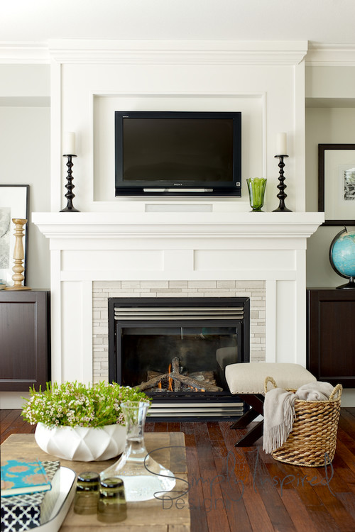 hanging your tv over the fireplace yea or nay driven by decor. Black Bedroom Furniture Sets. Home Design Ideas