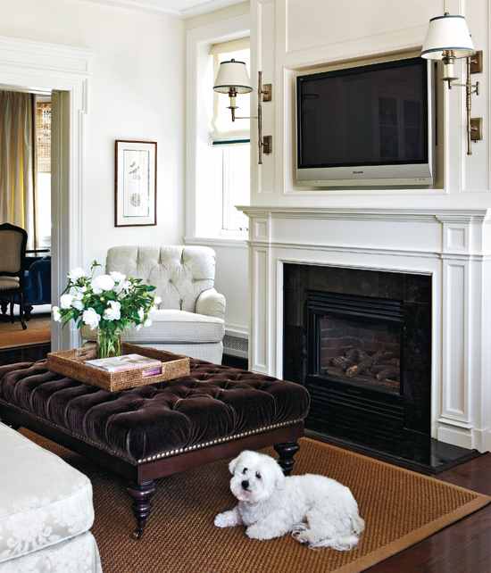 Loving how this tv over the fireplace is in a recessed niche and flanked by sconces - gorgeous!