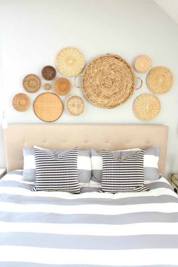 A collection of round baskets is a beautiful, inexpensive way to fill the wall space above your headboard!