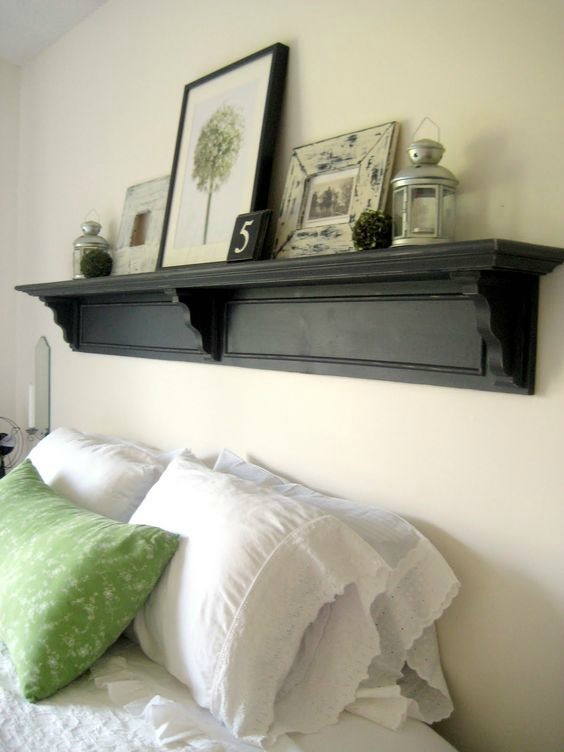 A Shelf Above The Bed With Art And Other Accessories Is Great Way To Fill