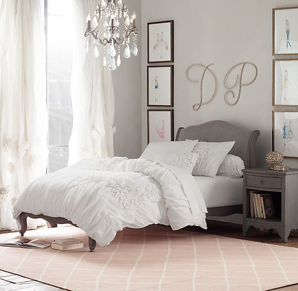 Large monogram letters fill the wall space above the headboard