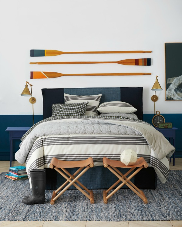 Three decorative oars hung above the bed as art