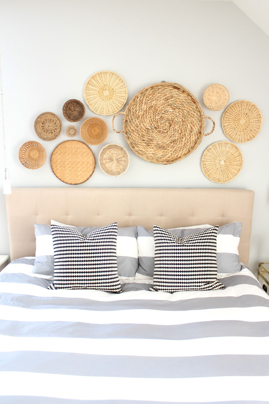 Using baskets is such a gorgeous idea for decorating the space above your bed! By Summer of Simple Stylings